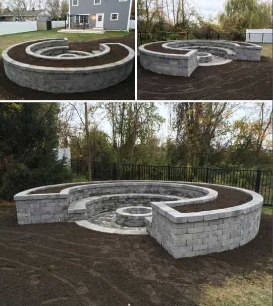 This elegant fire pit design comes with matching built-in seating and garden planter. Via Jersey Coast Landscaping