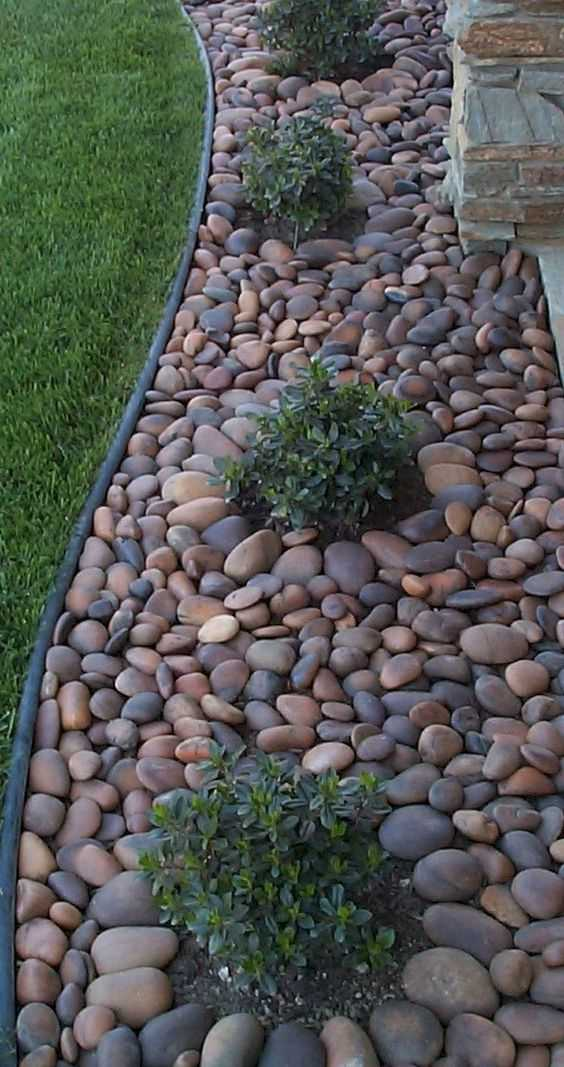 Use large pebbles rather than mulch to keep your garden beds looking chic and tidy. Via Livin King